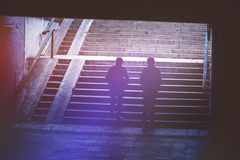 People in Urban Environment, Pedestrians Walking in Underground. Passage, Silhouettes of Two Women Climbing Concrete Stairs, Vintage Retro Tone Effect Royalty Free Stock Photo