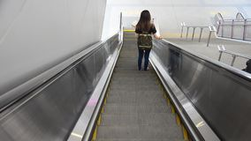 People use escalator for moving up and down at MRT Purple Line stock video footage