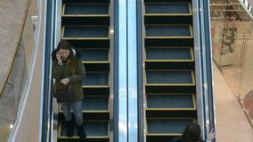 People use escalator in Ocean Plaza mall stock video