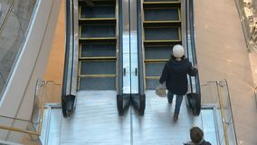 People use escalator in Ocean Plaza shopping centre stock video