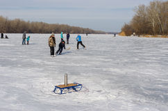 People use frozen river Dnepr for to go in for skating. Dnepropetrovsk, Ukraine - January 26, 2014: People in the city use frozen river Dnepr for to go in for stock photos