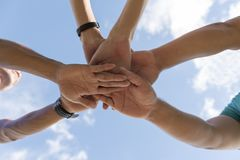 People use hand coordination. To express their collective strength royalty free stock images