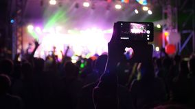 People use smart phones record video at music concert stock video