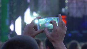 People phone music concert. People use smart phones video at music concert stock video