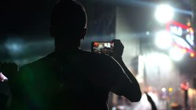 People phone music concert. People use smart phones video at music concert stock video footage