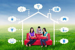 People use smartphone to control smart house Royalty Free Stock Photo