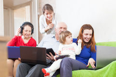 People  uses few various  devices at home Stock Images