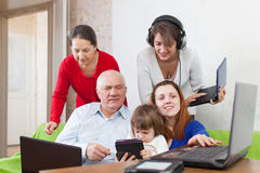 People  uses few various electronic devices Royalty Free Stock Photo