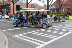 Trolley pub cycle pedal powered transportation tours in charlotte north caroliona. People using bicycle pedals to move themselves on a tour of charlotte north Royalty Free Stock Image
