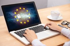 Free People Using Computer Laptop With Text GDPR Or General Data Protection Regulation Secure , Star And Padlock Logo On Monitor Screen Stock Images - 162463414