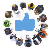 People Using Devices with Thumbs Up Symbol Royalty Free Stock Photo