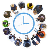 People Using Digital Devices with Clock Symbol. Diverse People Using Digital Devices with Clock Symbol Stock Images