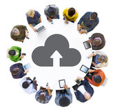 People Using Digital Devices with Cloud Symbol Royalty Free Stock Photos