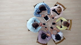 People using digital devices. Group of diverse people using digital devices stock video footage