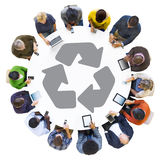People Using Digital Devices with Recycling Symbol. Diverse People Using Digital Devices with Recycling Symbol Stock Images