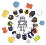 People Using Digital Devices with Robot Symbol. Diverse People Using Digital Devices with Robot Symbol Stock Photos
