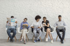 People using digital devices. Young people using digital devices Royalty Free Stock Photos
