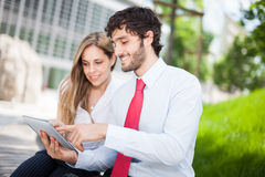 People using a digital tablet Royalty Free Stock Photo