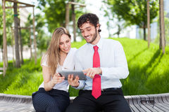 People using a digital tablet Stock Photo