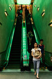 People using the escalator in shopping mall Stock Image