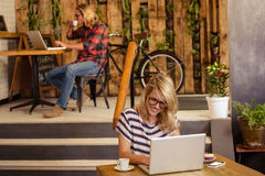 People using laptops. In the cafe stock photos