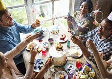 People Using Party Popper at a Birthday Celebration Royalty Free Stock Image