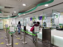 26 2 2021: people using post office in Hong Kong