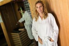 People using sauna at spa resort. People in bathrobes using sauna at spa resort Stock Photography