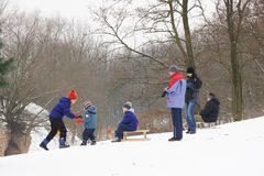 People using a sled in the winter Royalty Free Stock Photo