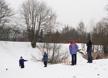 People using a sled in the winter Stock Photography