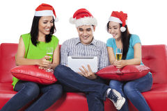 People using tablet and drink champagne Stock Photo