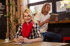 People using technology. In a cafe Royalty Free Stock Photography