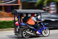 People using a tuk-tuk, it is a very common transport in the cit Stock Photo