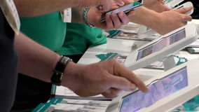 People using white tablets. Hands of people using white tablets and cell or mobile phone at the business centre center stock video