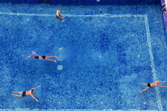 People on vacation in the swimmingpool Stock Photo