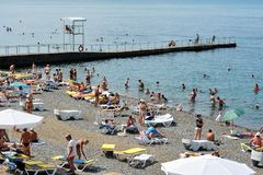 People vacationers on the black sea on the city beach of Sochi. Sochi, Russia - July 14, 2017: the people vacationers on the black sea on the city beach of Sochi Stock Photo