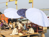 People in Varanasi. People are standing, sitting or taking a holy bath on the ghats of the holy city of Varanasi Stock Images