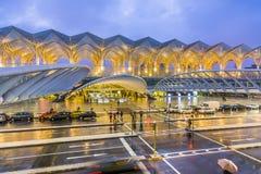 People at Vasco da Gama shopping center in rain Stock Photo