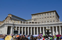 People at Vatican. People waiting for the Pope in front of the papal apartments, in St. Peter's Square, Vatican City Royalty Free Stock Photography