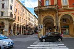 People and vehicles in Bologna. Bologna, Italy - August 18, 2014: People and vehicles at the intersection of Via dell'Indipendenza and Via Irnerio in Bologna Royalty Free Stock Image