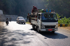 People and vehicles on mountain road in Inle, Myanmar Royalty Free Stock Photography