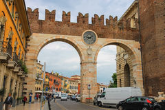People and vehicles near the medieval city gates in Verona Stock Image