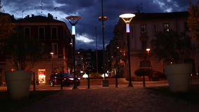 People and Vehicles Passing in Time Lapse at Night in Italy stock video footage