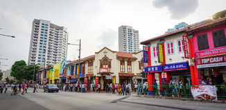 People and vehicles on street in Little India, Singapore.  Stock Image