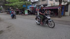 People and vehicles on street in Mandalay, Myanmar.  stock video