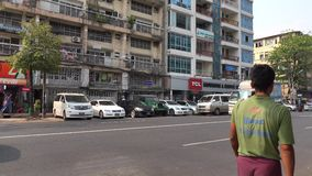 People and vehicles on street in Mandalay, Myanmar stock video
