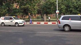 People and vehicles on street in Mandalay, Myanmar stock video footage