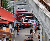 People with vehicles on street in Manila, Philippines Stock Image