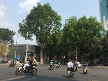 People and vehicles on street in Saigon, Vietnam Stock Photography