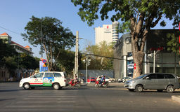 People and vehicles on street in Saigon, Vietnam Stock Image